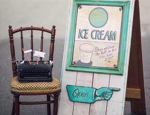 Sign board, antique typewriter, antique chair, and other vintage party decor rental items from wedding and event decor rental company Party Mood for an ice cream social themed event or photo shoot.