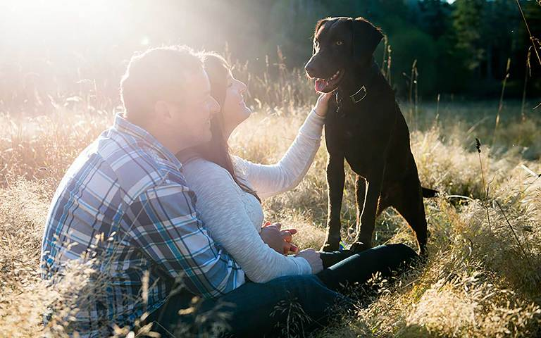 Victoria engagement photos of couple in a meadow in East Sooke with their dog by Jen Steele Photo & Film