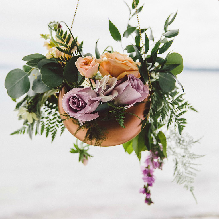 A bride's bouquet in a hanging copper planter for a modern Victoria wedding design by Party Mood.