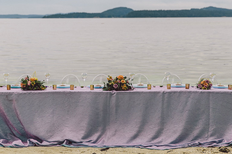 Beach side long wedding guest tablescape design by Party Mood