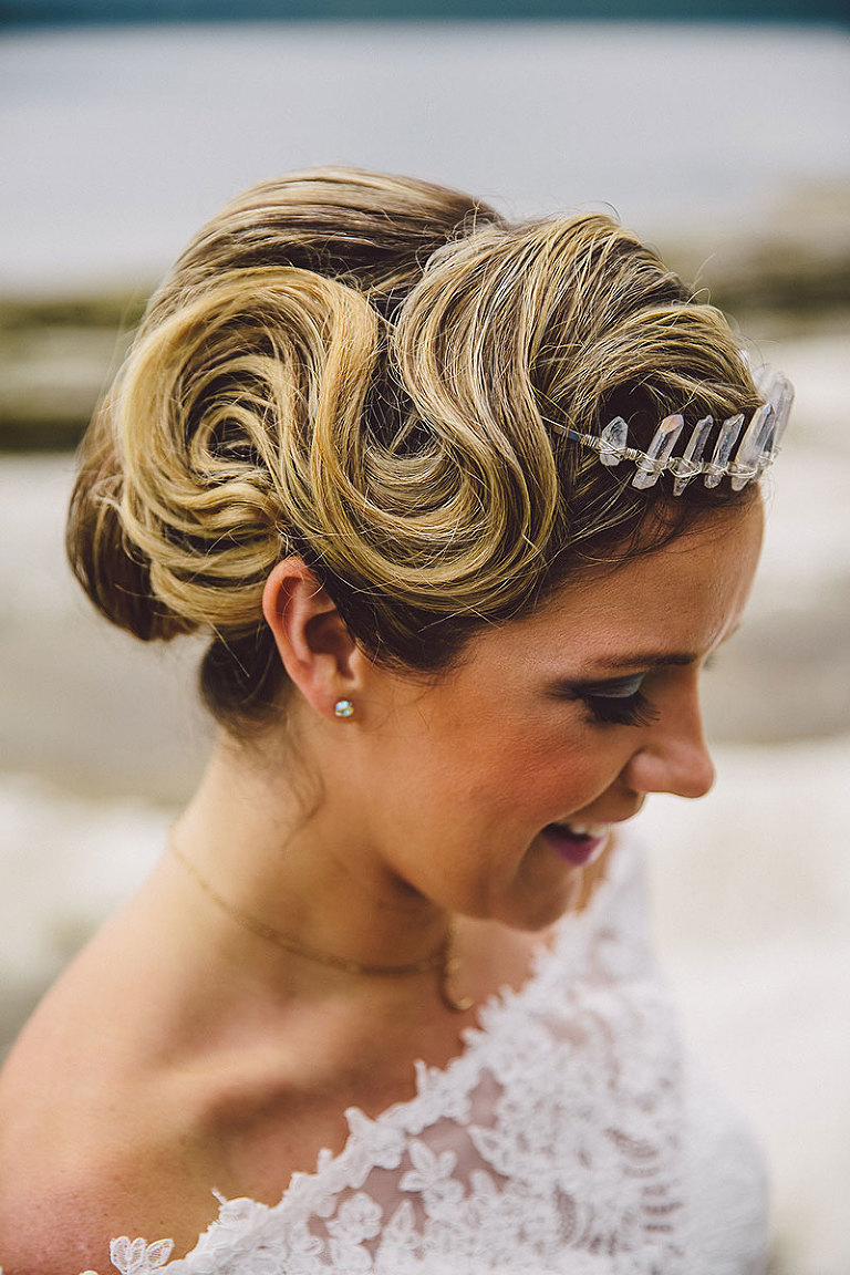 Bridal hairstyle design with exaggerated pin curls for a beachy look. Wedding styling by Party Mood.