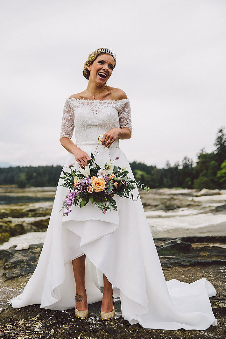 An off the shoulder style wedding dress with a high low skirt ideal for a shoreside wedding. Styled by Party Mood.