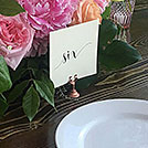 A rose gold table number holder from the wedding decor rental inventory of Victoria BC wedding planner Party Mood