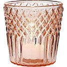 A rose gold glass votive holder from Party Mood wedding decor rentals.