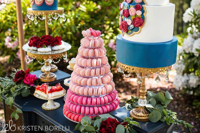 A colorfully decadent wedding dessert table designed for a Marie Antoinette inspired wedding style.