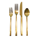 Four-piece gold cutlery table setting wedding decor rental
