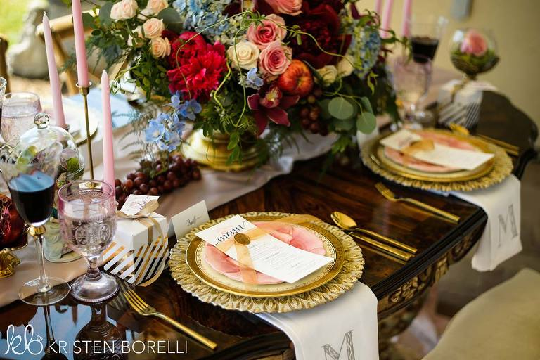 A Marie Antoinette themed wedding tablescape featuring Party Mood wedding decor rentals.