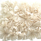 Cream Ruffled Accent Pillow wedding decor rental item.