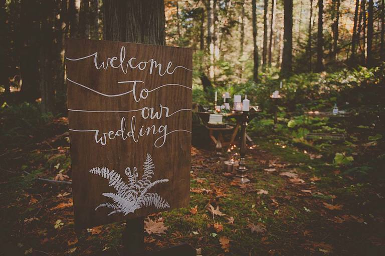 "A rustic ""Welcome To Our Wedding"" sign for a woodland inspired themed wedding makes the perfect entry point for the style shoot filled with rustic woodland wedding decor ideas."
