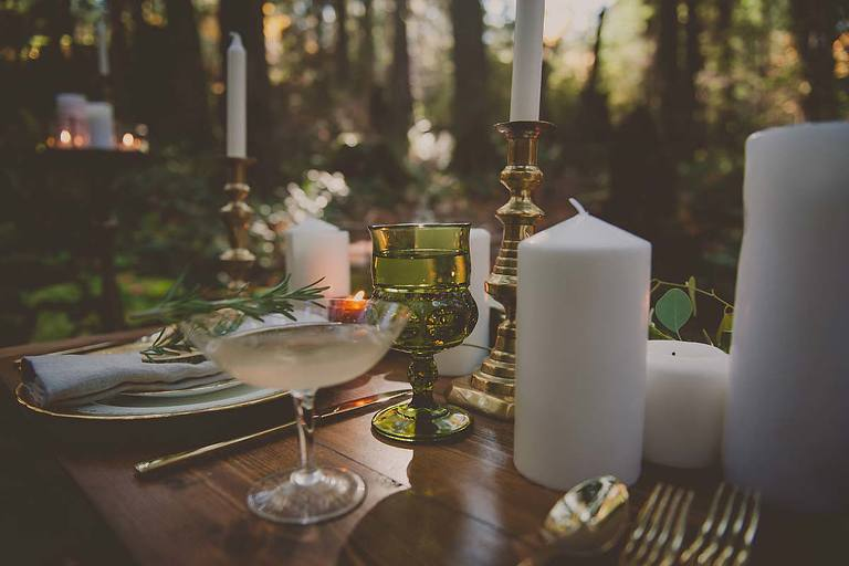 Table setting for a rustic forest wedding design.