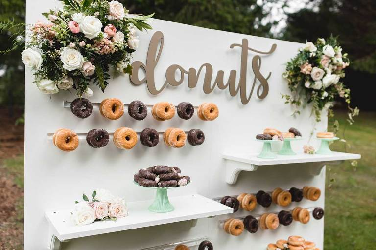 A donut wall is a fun new trend for wedding guests. Donut wall rental from Party Mood wedding decor rentals in Victoria BC.